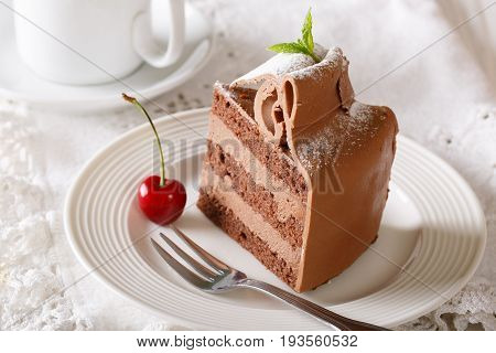 Rich Piece Of Chocolate Torte With A Delicate Cream Close-up. Horizontal