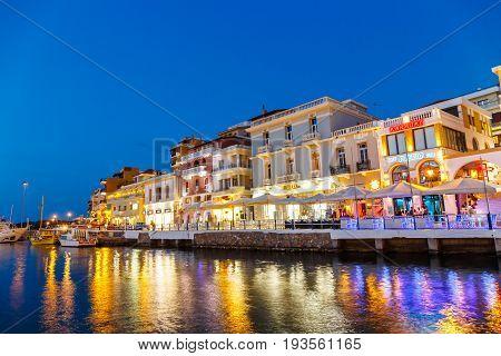 Agios Nikolaos, Crete, Greece - June 08, 2017: Agios Nikolaos Town At Summer Evening. Agios Nikolaos