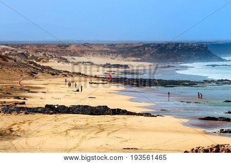 El Cotillo, Fuerteventura, Spain, April 03, 2017: Unknown Kitesurfers On A Beach In El Cotillo Villa