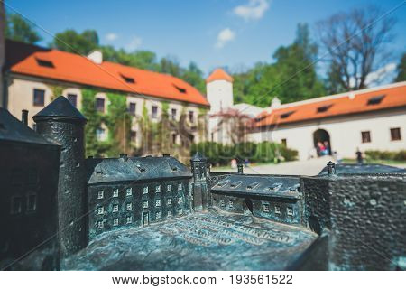 Pieskowa Skala, Poland - May 14, 2017: Model Of The Castle In Pieskowa Skala With Real Buildings In