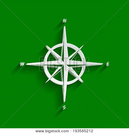 Wind rose sign. Vector. Paper whitish icon with soft shadow on green background.