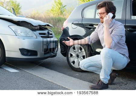 Man Calling Help After Car Crash Accident On The Road