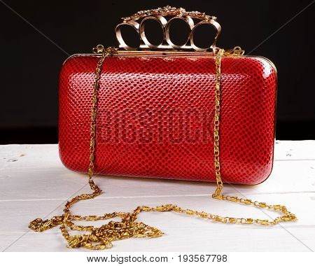 Red Hand Bag Clutch With Pen Brass Knuckle On Black Background
