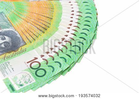 Money one hundred Australian dollar (AUD) banknotes spread out on white background