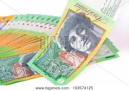 One hundred Australian dollar (AUD) banknotes on white background