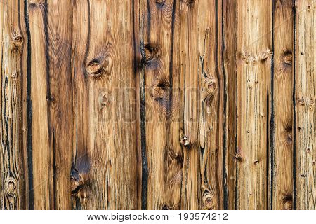 Natural brown barn wood wall. Wall texture background pattern. Wood planks, boards are old with a beautiful rustic and burned look, style.