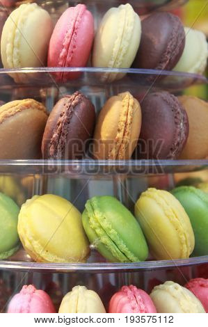Colorful macaron cookies for sale at luxury bakery in Paris, France