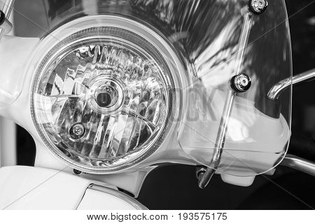 Motorcycle or Scooter headlight lamp with lamp light turned off and windshields for transportation or technology concept design.