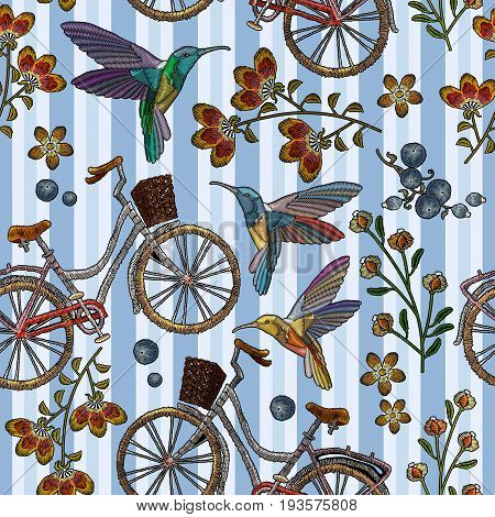 Embroidery bicycle with basket humming-bird and flowers seamless pattern. Fashionable embroidery bicycle humming bird and spring flowers romantic art template for clothes t-shirt design