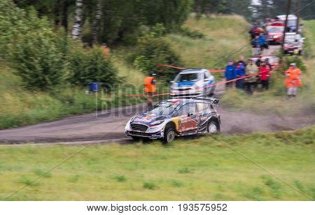 Mikolajki, Poland - 29 June 2017: Sebastien Ogier and his codriver Julien Ingrassia M-Sport World Rally Team in a Ford Fiesta WRC race in the 74nd Rally Poland, on June 29, 2017 in Mikolajki, Poland.