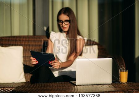 Young Beautiful Girl Use A Laptop During A Break At Work.