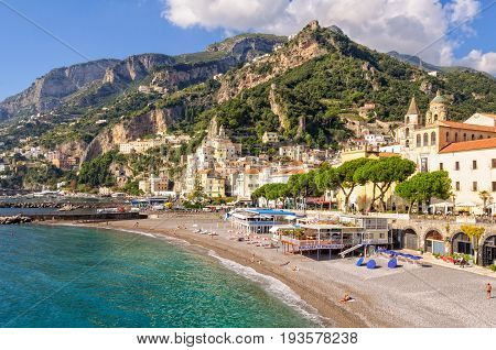 After the main tourist season just a few people relax and enjoy the mild autumn weather on the beach - Amalfi, Campania, Italy, 28 October 2011