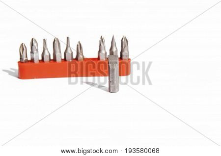 Chrome industrial screwdriver set with various bits and one bit extension and replaceable head