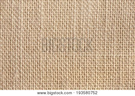 Abstract sackcloth background. Closeup of beige sackcloth texture