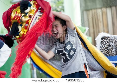Taipei Taiwan - FEBRUARY 11 2015: A child dance lion during the Chinese New Year.-select focus