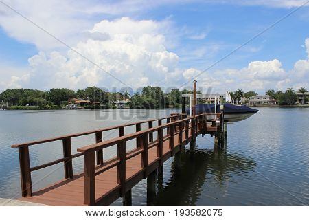 Wooden dock holds a boat ready to hit the Florida waterway