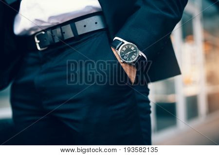 Business Man's Hand In Pocket Wearing A Watch