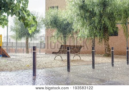 It Is Raining In A Children's Playground, Rain Drops Falling