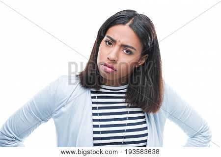 Irritated Young Woman Standing With Hands On Waist And Looking At Camera
