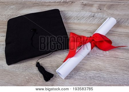 Graduation Cap, Hat With Degree Paper On Wood Table Graduation Concept