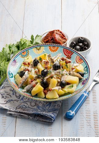 salad with potatoes anchovies dried tomatoes and black olives