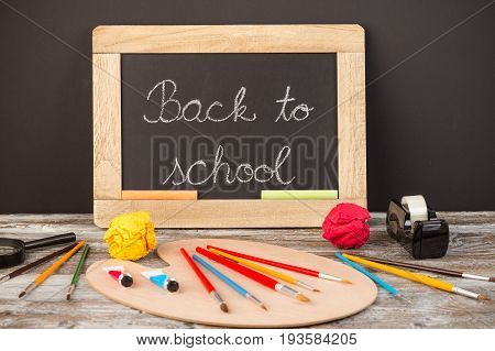 back to school school supplies on wooden background