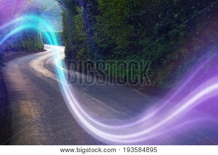 Curving Country Road Through Thick Forest with thick light beam running through it