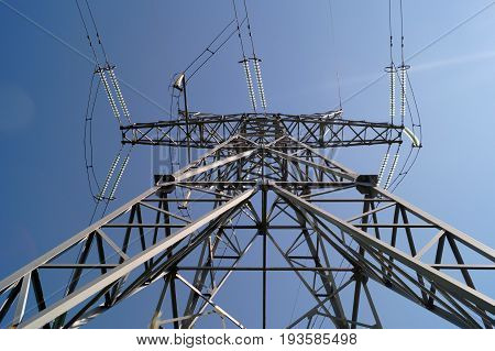 330 kilovolt powerline transmission pylon (bottom view). High voltage transmission tower for distribution electrical power.