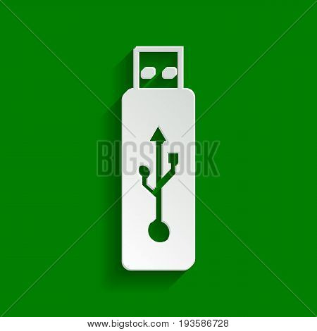 Vector USB flash drive sign. Vector. Paper whitish icon with soft shadow on green background.