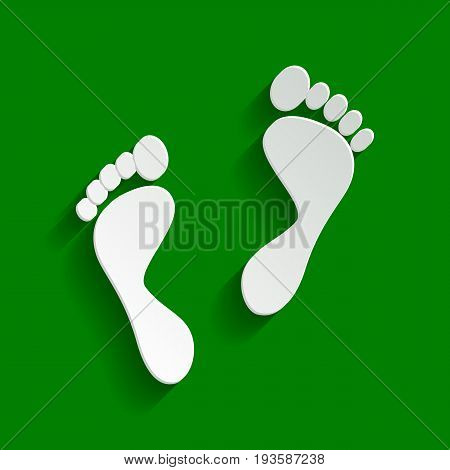 Foot prints sign. Vector. Paper whitish icon with soft shadow on green background.