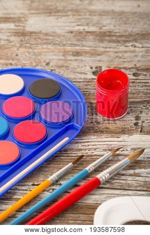 special painting tools on wooden background education tools for schools