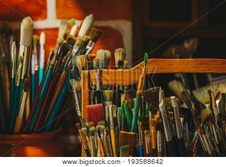 Set of paintbrushes for painting on wooden table