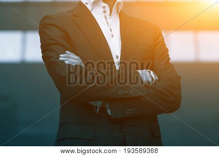 Success Business Man With Arms Crossed. Blue Toned Image. Business Men Lifestyle Concept.