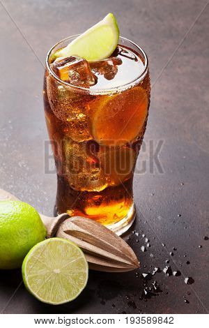 Cuba libre cocktail glass on stone table