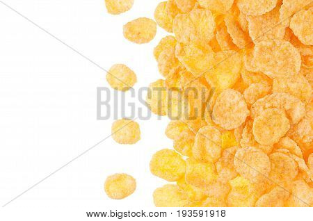 Decorative border of golden cornflakes isolated on white background. Cereals texture.