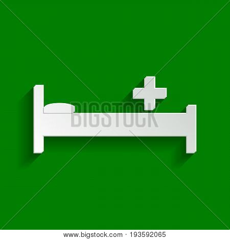 Hospital sign illustration. Vector. Paper whitish icon with soft shadow on green background.