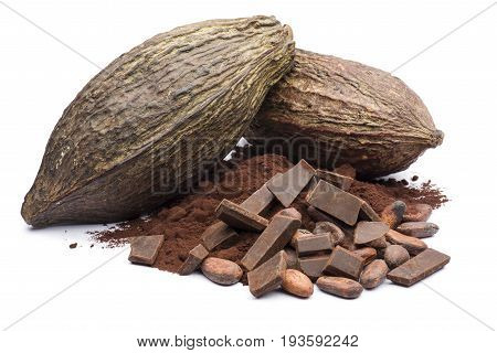 heap of dark cocoa powder with cocoa beans and chocolate block on white background