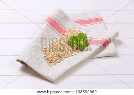 pile of pearl barley on folded place mat
