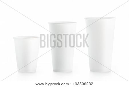 Blank white disposable paper cup mock ups isplated 3d rendering. Empty polystyrene coffee drinking mug mockup front view. Clear plain tea take away plastic package cofe shop branding template.