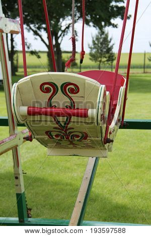A Two Person Wooden Swing at a Vintage Fun Fair.