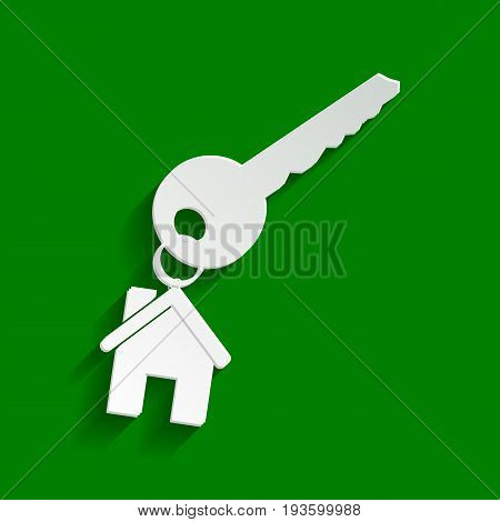 key with keychain as an house sign. Vector. Paper whitish icon with soft shadow on green background.