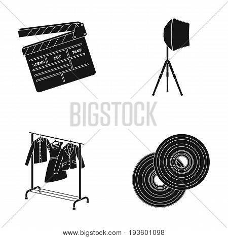 Movies, discs and other equipment for the cinema. Making movies set collection icons in black style vector symbol stock illustration .