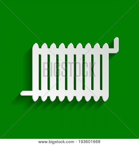 Radiator sign. Vector. Paper whitish icon with soft shadow on green background.
