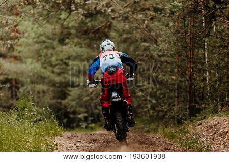 back athlete bike enduro rides in forest track racing motocross