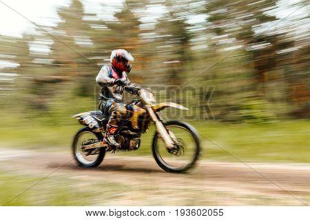 blurred motion athlete bike enduro championship motocross in forest