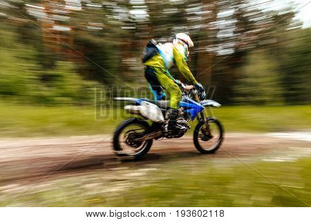 championship motocross in forest blurred motion motorcycle enduro