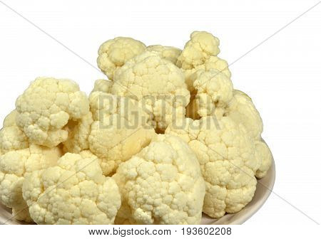 Head of cauliflower, disassembled on inflorescence, is ready for further culinary processing. Isolated on white background