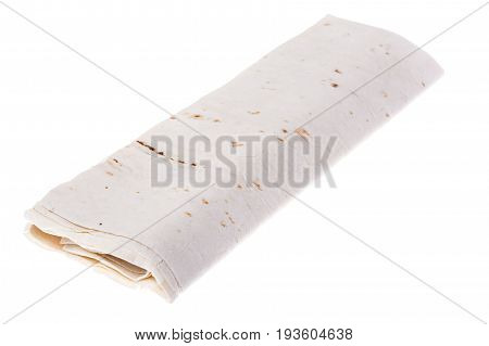 Thin lavash, rolled up, on white background. Studio Photo