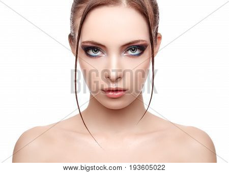 Beautiful spa model girl with perfect fresh clean skin wet effect on her face and body high fashion and beauty portrait creative makeup theme strobing or highlighting makeup look at the camera