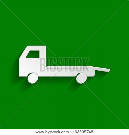 Service of evacuation sign. Wrecking car side. Car evacuator. Vehicle towing. Vector. Paper whitish icon with soft shadow on green background.